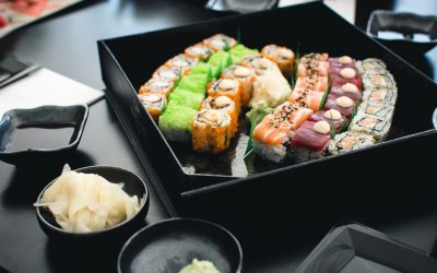 Sushi and soya dip with some vegetables