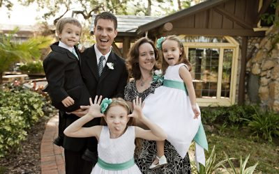 Happy married couple with smiling kids