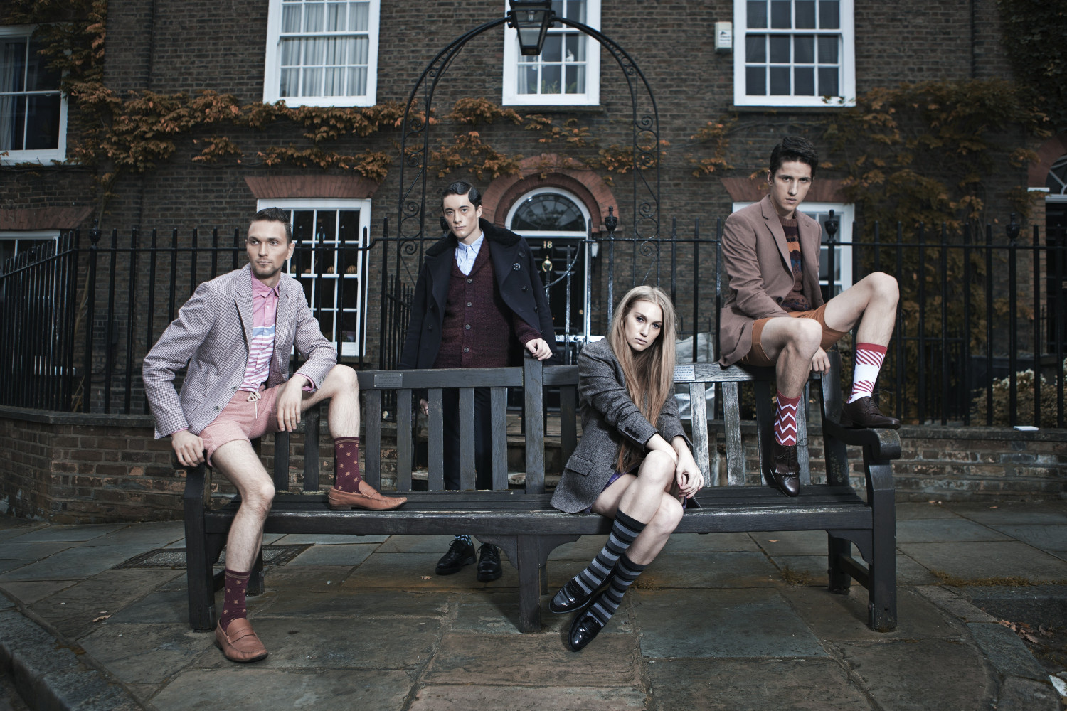 Photography of group of people sitting on bench